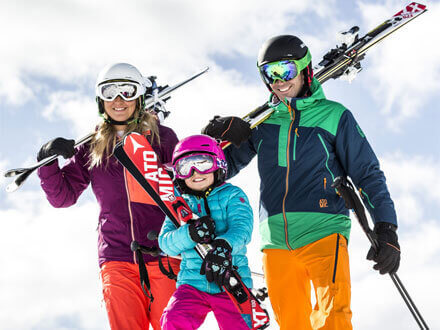 Photo of a family enjoying their ski holiday